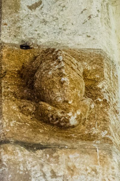 Nether Cerne, All Saints Church photo, A headless beast carving on the tower arch
