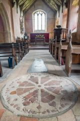 The peculiar wheel-cross design in the nave floor