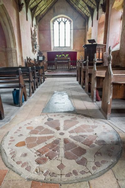 North Barningham, St Peter's Church photo, The peculiar wheel-cross design in the nave floor