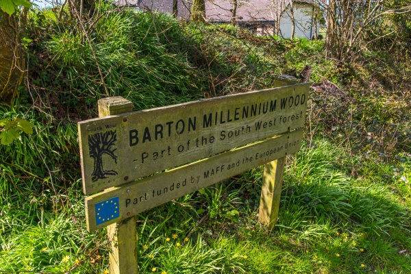 Footpath sign to the holy well via Barton Millennium Wood