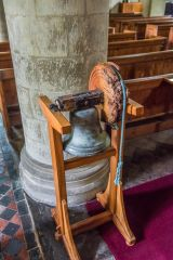 Over Wallop, St Peter's Church, An old bell stands in the nave