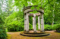 A classical temple in a wooded glade