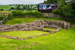 A train rushes past Poltross Burn Milecastle
