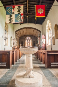 The 18th century font and nave