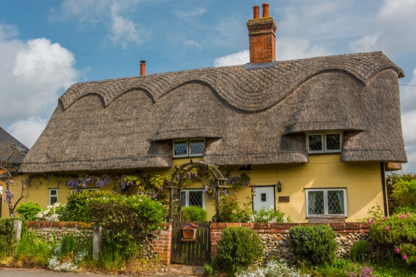 A thatched cottage on the green in Redgrave