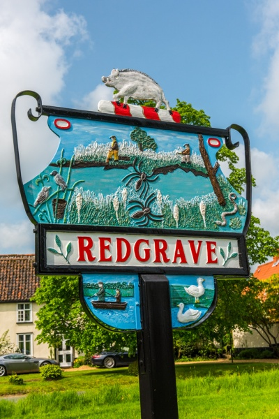 The village sign on the green
