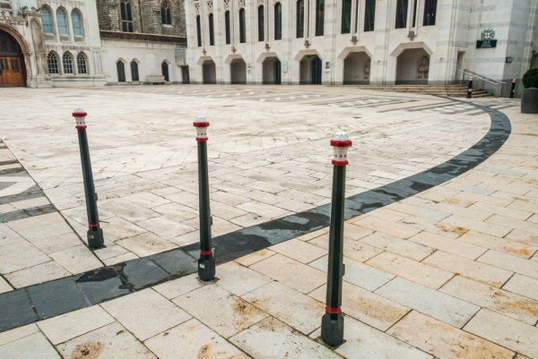 Black stones mark the outline of the amphitheatre in Guildhall Yard