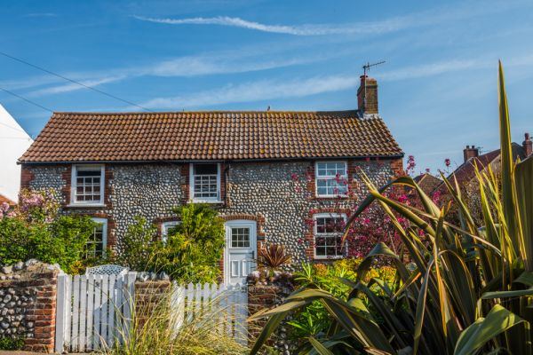 Sheringham photo, A pretty flint and brick cottage