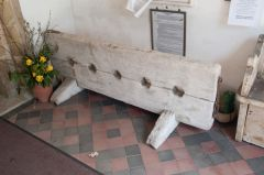 Village stocks in the church porch