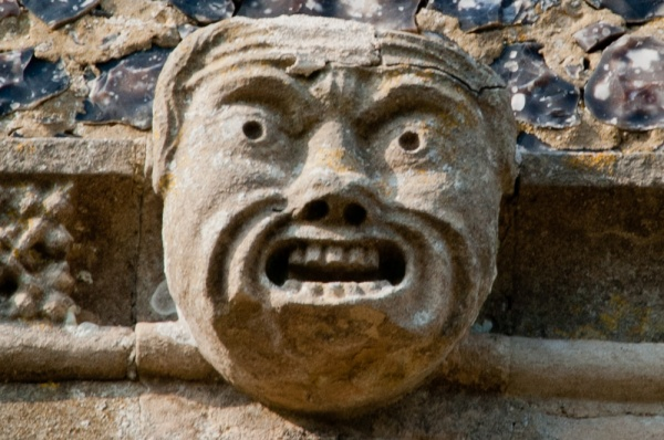 15th century grotesque face on the clerestory frieze