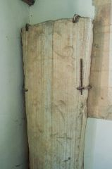 Medieval coffin lid with a floriated cross carving