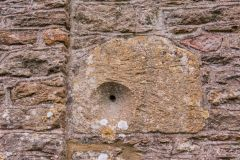 A mass dial set into the outer wall