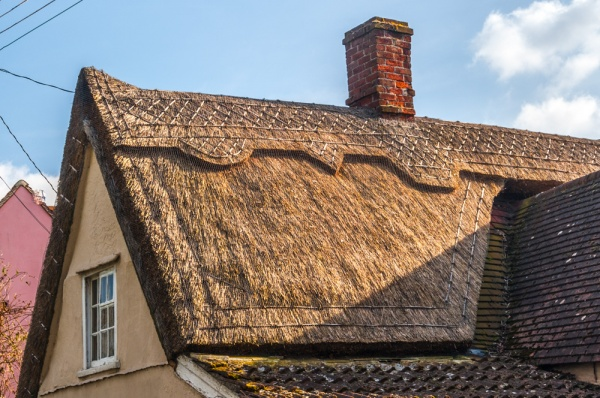 A thatched roof bathed in evening sunlight