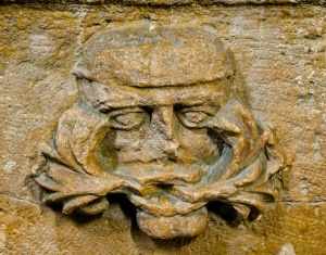 Green Man carving on the font
