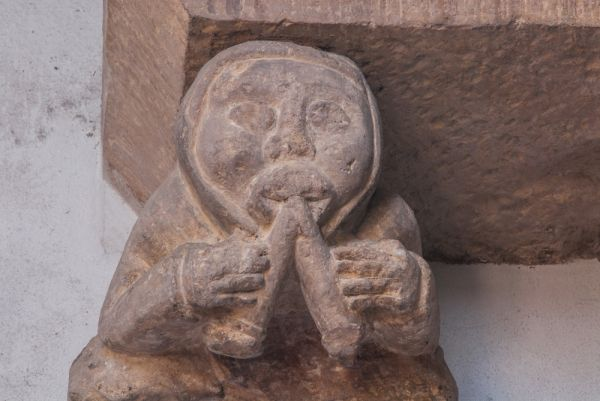 Stow Minster photo, 15th century figure of a musician playing a double auloc