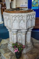 The 14th century font in St Michael's Church