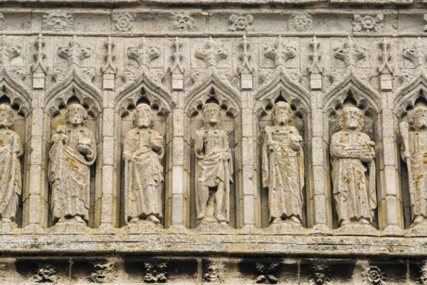 Carved figures on the west front of Thorney Abbey