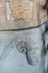 Closeup of the ram's head on the font