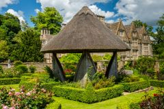 A thatched summerhouse in the formal gardens