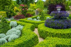 Clipped hedges and colourful flowers in the formal gardens