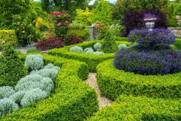 Upper Slaughter Manor photo, Clipped hedges and colourful flowers in the formal gardens