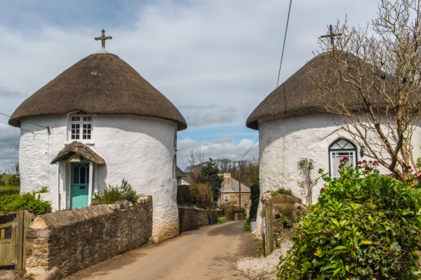A pair of the famous Veryan thatched roundhouses