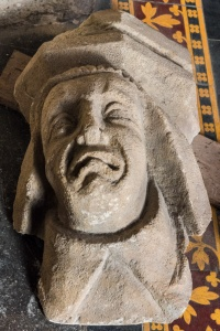 Carved head in the chancel