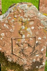 19th century gravestone with heraldic arms