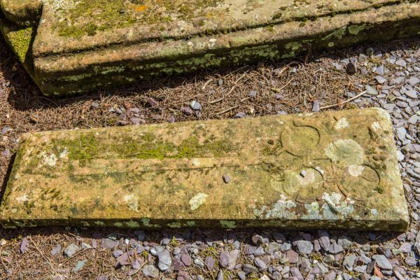 Wetheral, Holy Trinity & St Constantine Church photo, A medieval grave slab with a floriated cross carving