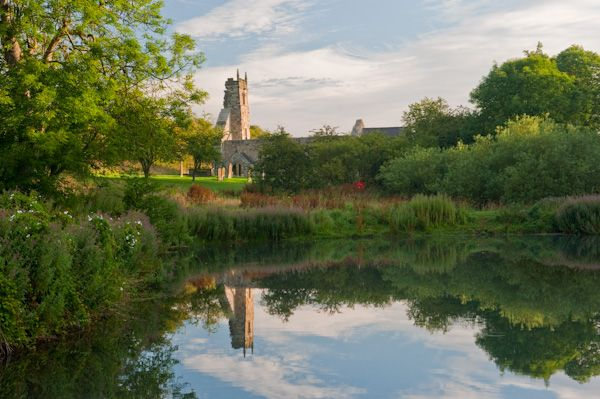 Wharram Percy Deserted Medieval Village photo, The mill pond and church tower