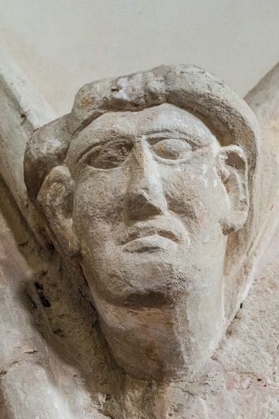 Whitchurch Canonicorum, St Candida & Holy Cross Church photo, 13th century carving of a head on the nave arcade