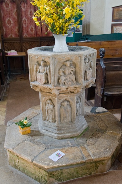 The beautifully carved 15th century font