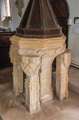 The ornately carved font