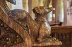 15th century carved bench end of a dog