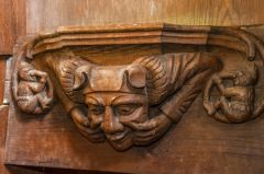 Misericord of a man making a grotesque face