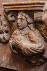 Angel holding a heart misericord