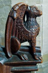 Medieval bench end of a winged figure