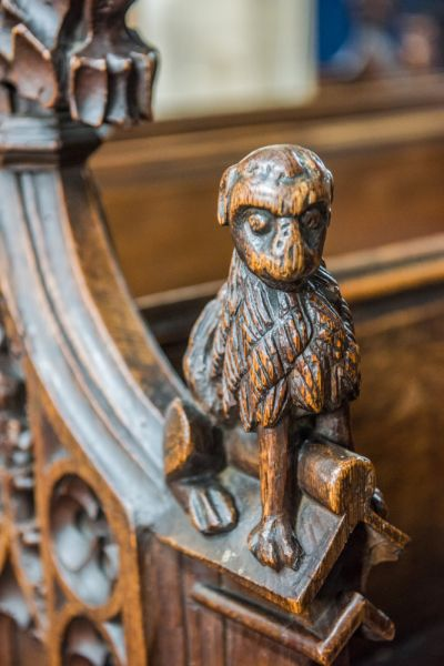 Woolpit, St Mary's Church photo, Medieval bench end of a dog