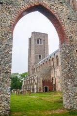Wymondham Abbey, The east tower through the chapter house arch