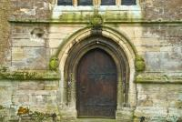 West door Highworth church, with cannon hole